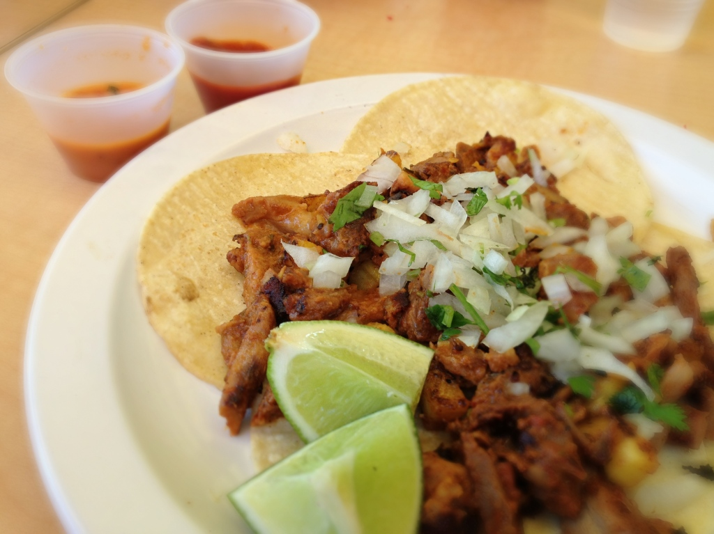 Tacos al Pastor,  pineapple-marinated and fresh tortillas