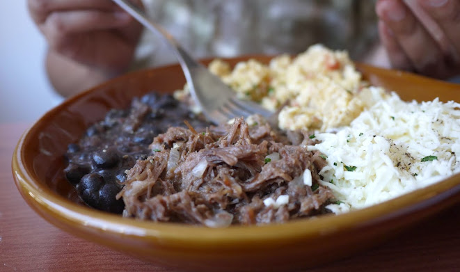 Julieta's caraqueno: a corn bread served with scrumbled eggs, black beans, grouded beef, cheese and creme fraiche