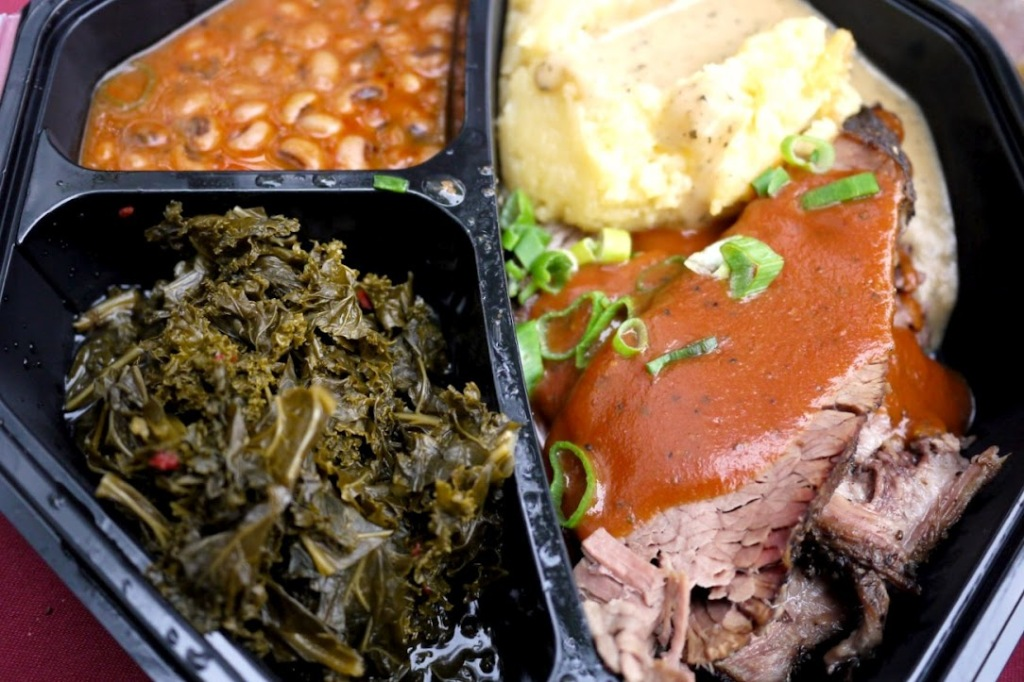 Brisket with mashed potatoes, braised greens and black eye peas