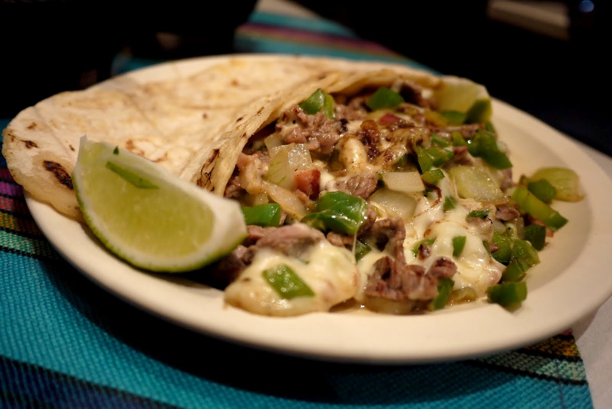 La Matraca tacos are served on freshly made corn tortillas with super tasty marinated meats